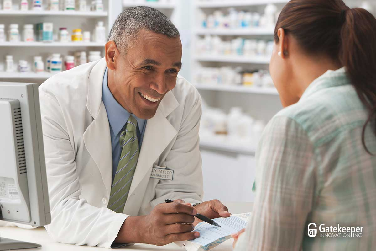 Image of friendly pharmacist explaining to a patient how Western Health Advantage offers Gatekeeper Innovation Inc.'s Rx Locking Cap as a covered benefit to its members. Learn more about this exciting new benefit for WHA members.